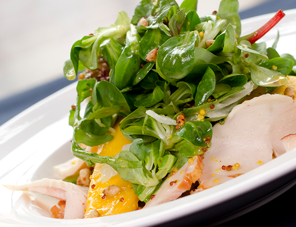 Low in calories, this fancy salad offers protein, dietary fiber, and a dose of healthy fat that stands alone as a complete meal for a hot day.
